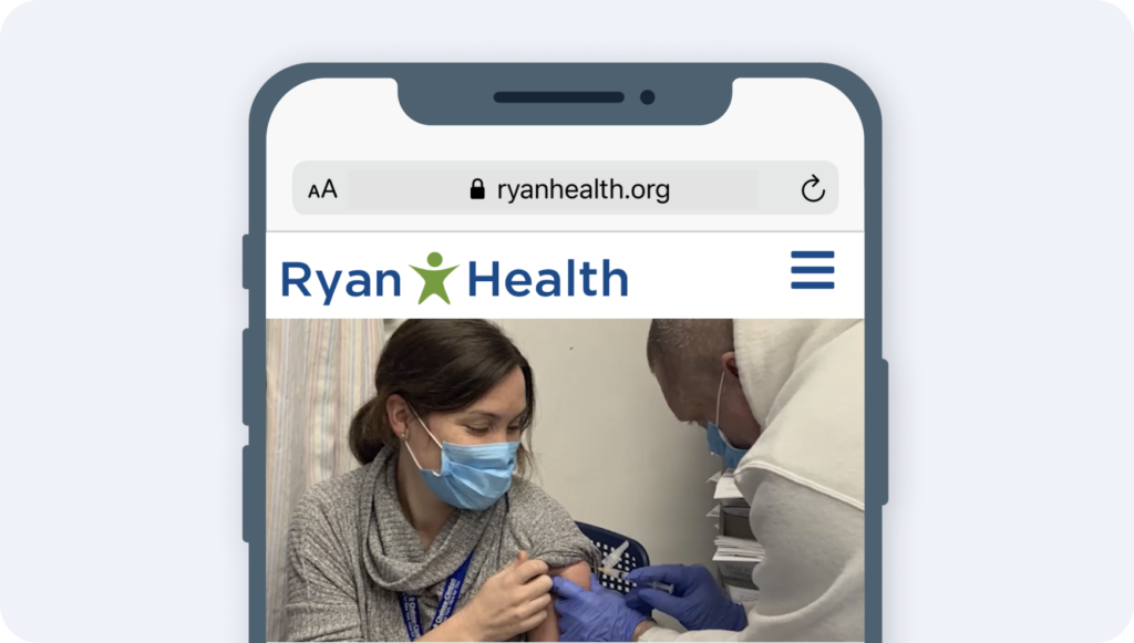 woman wearing a mask receiving a vaccine from a man wearing a mask